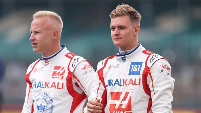 NORTHAMPTON, ENGLAND - JULY 15: Nikita Mazepin of Russia and Haas F1 and Mick Schumacher of Germany and Haas F1 look on as the prototype for the 2022 F1 season is unveiled during previews ahead of the F1 Grand Prix of Great Britain at Silverstone on July 15, 2021 in Northampton, England. (Photo by Lars Baron/Getty Images)