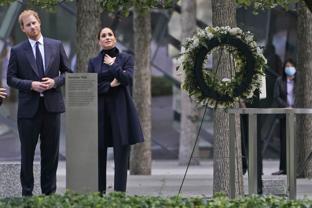 Meghan Markle and Prince Harry pause while getting a tour of the National September 11 Memorial & Museum in New York, Thursday, Sept. 23, 2021. The Duke and Duchess of Sussex got a hawk's-eye view of New York City with a visit to the rebuilt World Trade Center's signature tower. (AP Photo/Seth Wenig)