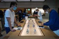 SINGAPORE, SINGAPORE - SEPTEMBER 24: People try out newly released products at the Apple Store in Orchard Road on September 24, 2021 in Singapore. Apple announced September 14 the release of four variants of its latest iPhone 13, alongside other upgrades to its product lineup. (Photo by Feline Lim/Getty Images)
