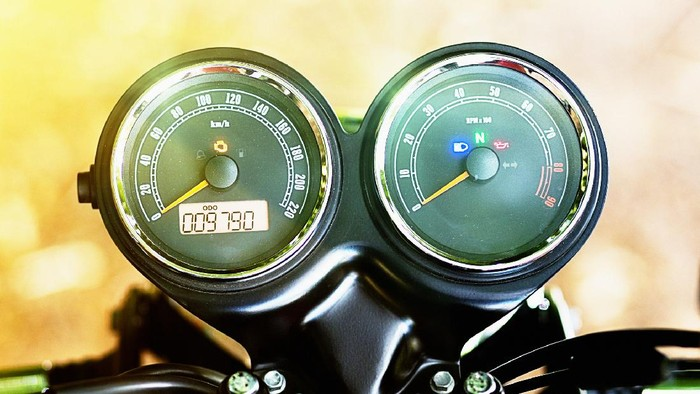 Detail of Retro-style motorbike, showing rev counter and speedometer.