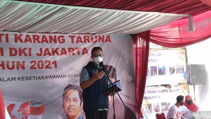 Gubernur DKI Anies Baswedan ketika memberikan sambutan pada Bulan Bhakti Karang Taruna di Jakarta, Minggu (26/9/2021). ANTARA/Dewa Ketut Sudiarta Wiguna