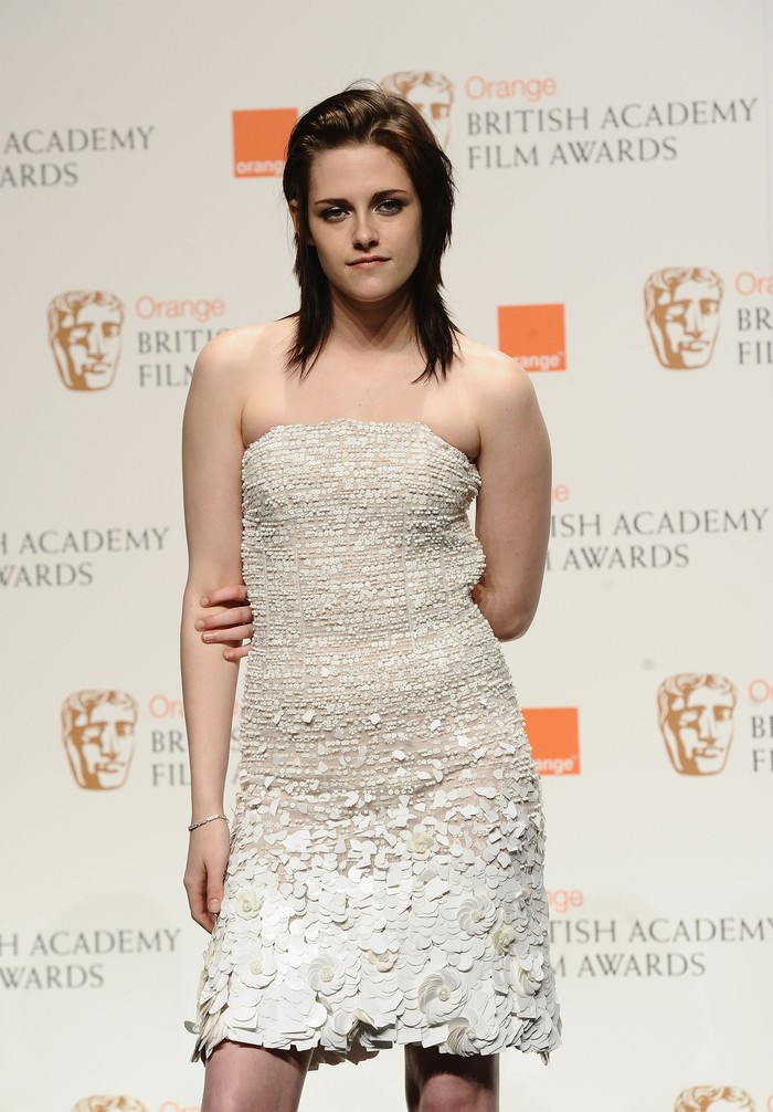 LONDON, ENGLAND - FEBRUARY 21:  Kristen Stewart celebrates winning the Orange Rising Star Award at the Orange British Academy Film Awards at the Royal Opera House on February 21, 2010 in London, England. The Orange Rising Star Award is the only award voted for by the public. Kristen Stewart was one of five international actors and actresses nominated whose talent has inspired popular acclaim from the British public. .  (Photo by Ian Gavan/Getty Images)