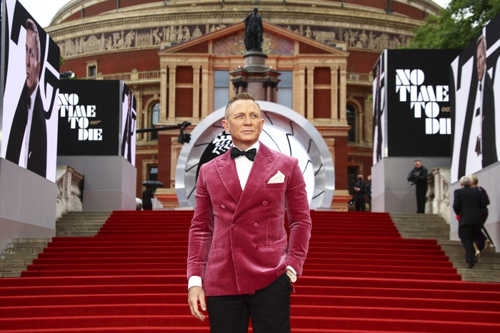 Daniel Craig poses for photographers upon arrival for the World premiere of the new film from the James Bond franchise No Time To Die, in London Tuesday, Sept. 28, 2021. (Photo by Joel C Ryan/Invision/AP)