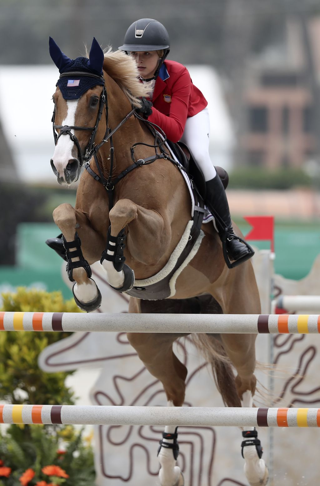 LIMA, PERU - AUGUST 07: Eve Jobs of United States riding Venue D'Fees Des Hazalles competes during equestrian Jumping Team at Army Equestrian School on Day 12 of Lima 2019 Pan American Games on August 7, 2019 in Lima, Peru. (Photo by Raul Sifuentes/Getty Images for FEI)