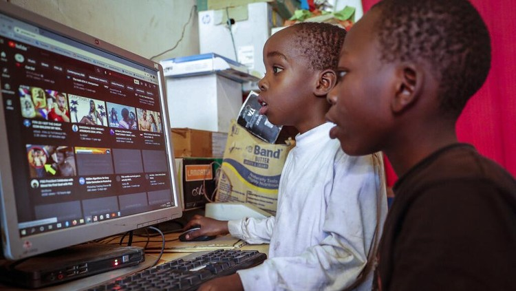 Two young boys use a computer at an internet cafe in the low-income Kibera neighborhood of Nairobi, Kenya Wednesday, Sept. 29, 2021. Instead of serving Africas internet development, millions of internet addresses reserved for Africa have been waylaid, some fraudulently, including in insider machinations linked to a former top employee of the nonprofit that assigns the continents addresses. (AP Photo/Brian Inganga)