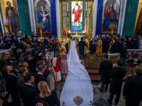 Grand Duke George Mikhailovich Romanov (L) welcomes Victoria Romanovna Bettarini accompanied by her father, Roberto Bettarini, as they arrive for the wedding ceremony at Saint Isaac's Cathedral in Saint Petersburg, on October 1, 2021. - Russia was to hold its first royal wedding, on October 1, 2021, since the 1917 Bolshevik revolution toppled the Romanov monarchy, with royals from across Europe expected at the lavish ceremony. Grand Duke George Mikhailovich Romanov, 40, and his Italian fiance Rebecca Virginia Bettarini, 39, will say their vows at the Saint Isaac's cathedral in the former imperial capital Saint Petersburg in the presence of dozens of royals. (Photo by Olga MALTSEVA / AFP)