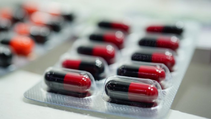 Close-up red and black Medicine Capsules in Blister Packs