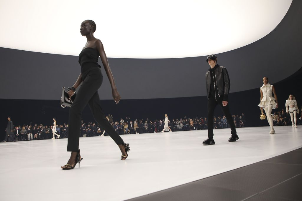 Models wear creations for the Givenchy Spring-Summer 2022 ready-to-wear fashion show presented in Paris, Sunday, Oct. 3, 2021. (Photo by Vianney Le Caer/Invision/AP)