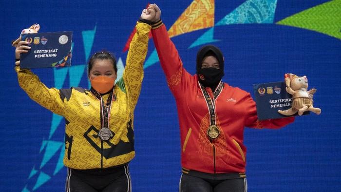 Lifter putri Jawa Tengah Diah Ayu P raih medali emas dari angkat besi pada kelas 76 kg. Raihan itu menambah medali yang telah dikumpulkan Jateng di PON XX Papua