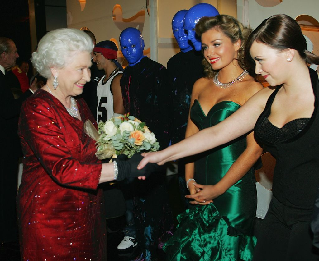 CARDIFF, UNITED KINGDOM - NOVEMBER 21:  (NO PUBLICATION IN UK MEDIA FOR 28 DAYS) HM Queen Elizabeth II meets singers Charlotte Church (R) and Katherine Jenkins as The Blue Man Group look on, backstage following the Royal Variety Performance, November 21, 2005 in Cardiff, Wales.  (Photo by Daily Mirror-Pool/Anwar Hussein Collection/Getty Images)