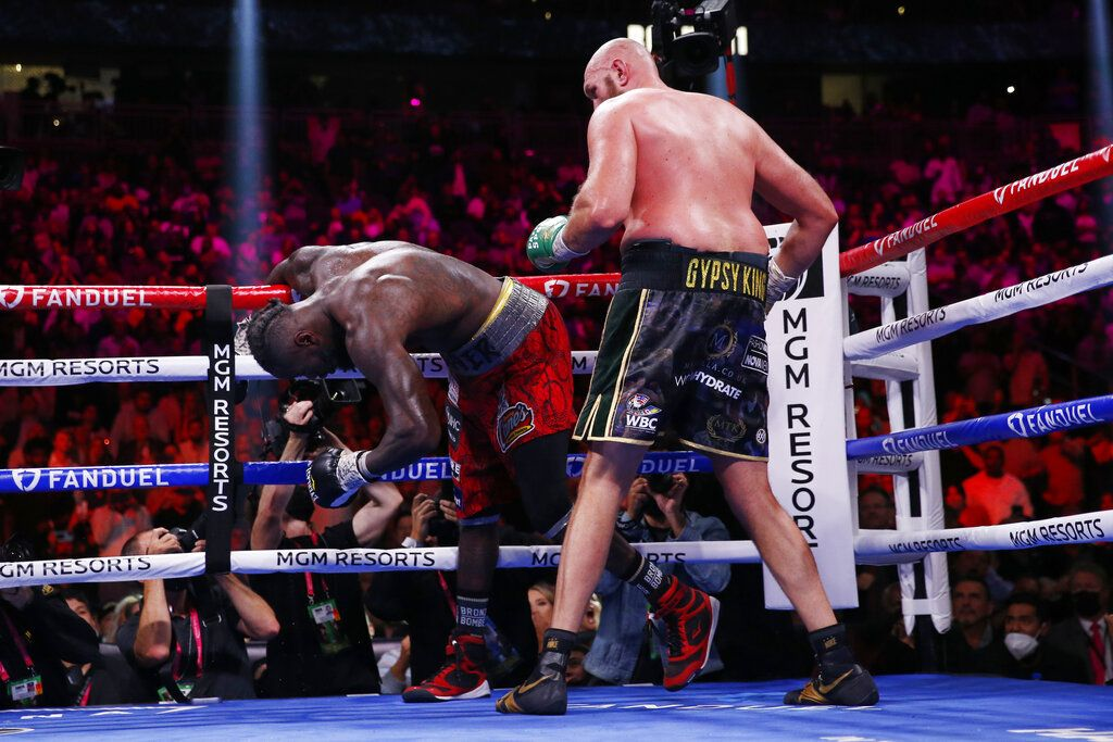 Tyson Fury, of England, knocks out Deontay Wilder to win in the 11th round in a heavyweight championship boxing match Saturday, Oct. 9, 2021, in Las Vegas. (AP Photo/Chase Stevens)