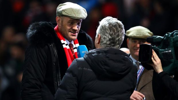 MANCHESTER, ENGLAND - DECEMBER 05:  Boxer Tyson Fury is interviewed during half time during the Premier League match between Manchester United and Arsenal FC at Old Trafford on December 5, 2018 in Manchester, United Kingdom.  (Photo by Clive Brunskill/Getty Images)
