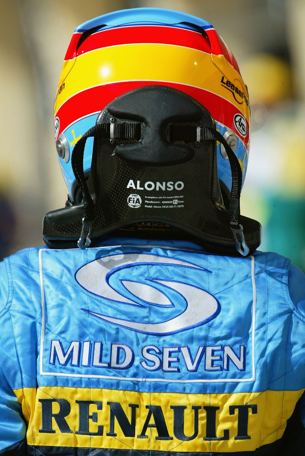 SAKHIR, BAHRAIN - APRIL 2:  Fernando Alonso of Spain and Renault wears the HANS safety device during practice for the Bahrain F1 Grand Prix at the Bahrain Racing Circuit on April 2, 2004 in Sakhir, Bahrain  (Photo by Bryn Lennon/Getty Images)