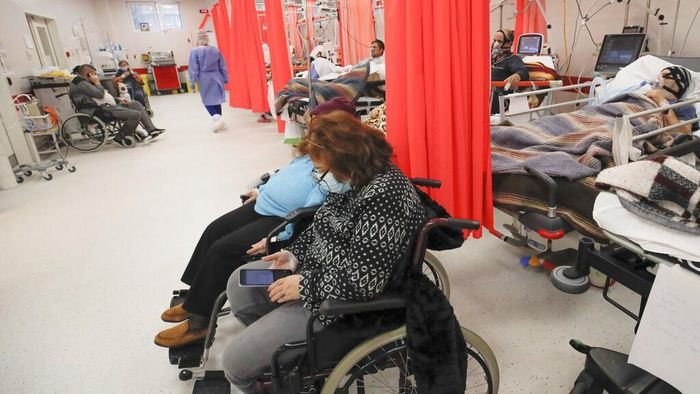 Patients lie on beds in the emergency room, turned into a CODIV-19 unit due to the high number of cases, at the Bagdasar-Arseni hospital in Bucharest, Romania, Tuesday, Oct. 12, 2021. (AP Photo/Andreea Alexandru)