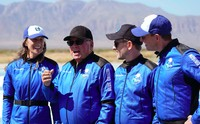 """Audrey Powers, left, speaks as William Shatner, from left, Chris Boshuizen and Glen de Vries look on during a media availability at the Blue Origin spaceport near Van Horn, Texas, Wednesday, Oct. 13, 2021.  The """"Star Trek"""" actor and the three fellow passengers hurtled to an altitude of 66.5 miles (107 kilometers) over the West Texas desert in the fully automated capsule, then safely parachuted back to Earth in a flight that lasted just over 10 minutes. (AP Photo/LM Otero)"""