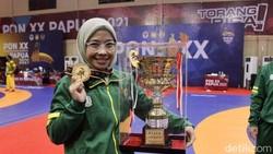 Mengenal Shintia Eka, Atlet Gulat Berhijab Peraih Medali Emas PON Papua