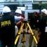 Sekitar 6 petugas dari Pusat Identifikasi Mabes Polri melakukan pemindaian di lokasi ledakan di Hotel Ritz Charlton, Mega Kuningan, Jakarta.