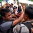 Massa dari Front Mahasiswa Makassar Anti Rezim SBY-Boediono terlibat saling dorong saat mahasiswa berusaha menurunkan bendera di halaman kantor DPRD Sulsel.