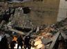 Bangunan yang berjarak sekitar 50 meter dari tenda tempat Kadhafi umumnya bertemu tamu rata dengan tanah. AFP/Imed Lamloum.