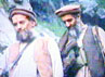 Osama Bin Laden berjalan bersama Ayman al-Dhawaheri di lokasi yang tidak ditentukan. Video tersebut ditayangkan oleh stasiun Al-Jazeerah 10 September 2003. (Photo by Salah Malkawi/Getty Images).
