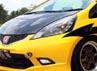 Di bagian eksterior, sunroof Webasto yang kemudian dipadu dengan spoiler Modulo, JDM taillight, carbon hood Revolution, LED pada foglamp dan headlamp yang kemudian dilapisi cutting stiker nyentrik yang membuat tampilan mobil ini berbeda dan lebih sporty dibanding Jazz pada umumnya.