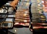 Selain uang dan senjata api, polisi juga mengamankan sejumlah handphone.