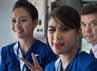 Dua orang pramugari siap menyambut tamu undangan yang akan memasuki pesawat, Rabu (9/5).  (dok Sergey Dolya)