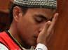Terdakwa 1 Rahmat Awifi mengusap wajahnya ketika mendengar hukuman 15 tahun yang akan dijalaninya.