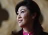 Yingluck disela-sela parade angkatan udara di Bangkok beberapa waktu lalu. Dengan usia  yang masih terbilang muda untuk memimpin pemerintahan, 45 tahun ia sanggup meredam konfilk sipil tahun lalu. (Reuters/Sukree Sukplang).