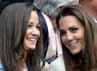 Pippa terlihat mengenakan dress bernuansa biru bermotif dan Kate memakai dress putih polos. REUTERS/Toby Melville.