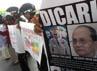 Massa peserta aksi peduli ini membawa foto Presiden Myanmar Thien Shein dan pimpinan junta militer Myanmar Jenderal Than Shwe. (M Nur Abdurahman/detikcom).