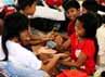 Beberapa anak mengisi hari-hari di pengungsian dengan bermain bersama.