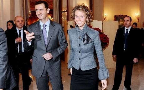 Presiden Assad & istrinya, Asma (AFP)