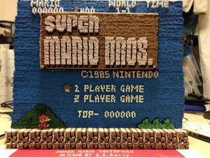 14.000 Tusuk Gigi Disulap Jadi Menu Game Super Mario Bros