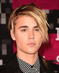 Bagaimana menurut kamu rambut polem Justin Bieber ini, Belieber? Jason Merritt/Getty Images/detikFoto.