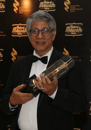 George Kamarullah menerima penghargaan spesial FFI 2015 (Asep Saepullah/detikHOT)