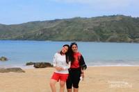 Mempercantik foto dengan latar pemandangan Pantai Kuta