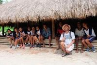 Bersama warga di salah satu rumah adat