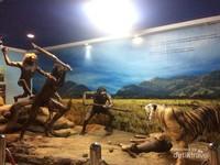 Diorama makhluk purbakala berburu
