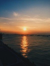 Sunset di sini termasuk syahdu dengan warna keemasannya