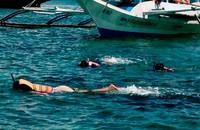 Snorkling sebelum menuju ke Crystal Cove Island