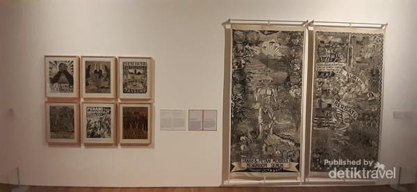 Lukisan hasil karya komunitas Taring Padi yang diciptakan dari pahat kayu berbentuk stempel, kemudian diberi tinta dan dicap di atas kain