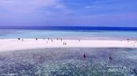 bentuk pasir timbul Gusung Tallu memanjang.