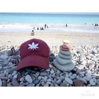 Pantai Kolbano dengan batu kerikil berwarna-warni disepanjang tepinya.