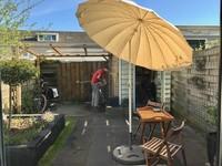Menikmati suasana halaman belakang rumah dengan membaca atau sekedar membersihkan sepeda-sepeda kami