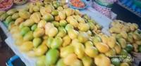 Buah mangga di pasar Dao Hueang Pakse.