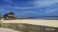 Pasir putih dengan latar Samudra Hindia