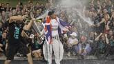 Lewis Hamilton sendiri menganggap gelar juara dunia F1 2014 terasa lebih spesial daripada gelar juara yang diraihnya pada musim 2008. (Reuters/Caren Firouz)