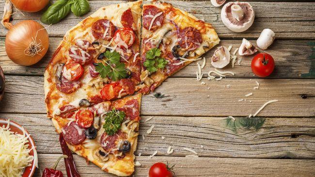 Cara Makan Pizza Bisa Menggambarkan Kepribadian Anda