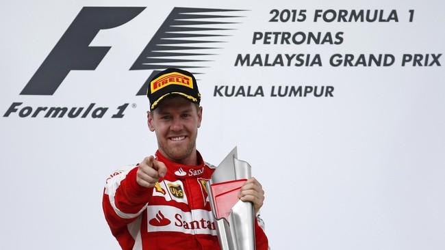 Kemenangan hari in menjadi podium pertama yang keempat bagi Sebastian Vettel di seri grand prix Malaysia yang berlangsung di sirkuit Sepang. Kemenangan terbanyak di Sepang sepanjang sejarah F1. (Reuters / Olivia Harris)